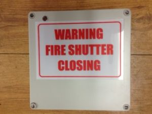 Roller Shutter Warning Sign